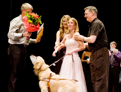 Kolby Garrison wins her age category for the 2010 Triad Idol with her guide dog, Sunny, by her side.