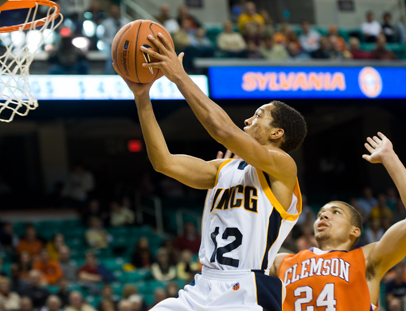 UNCG's #12 goes up for a layup as a Clemson defender gets close.