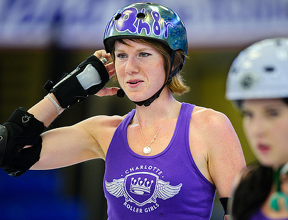 Caitlin Cornwell '06 smiles as she and her teammates prepare for a roller derby bout in Charlotte, NC, on Saturday May 7.