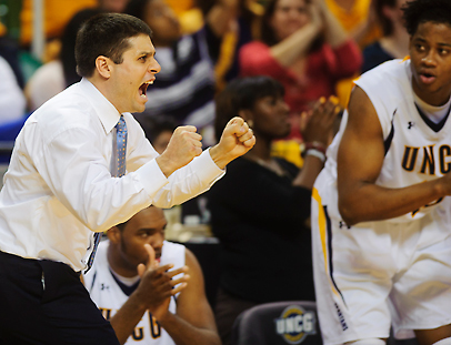 UNCG Head Coach Wes Miller cheers after taking the lead.