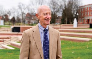 Former Chancellor William Moran poses for photo at Moran Commons and Plaza