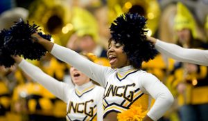 Photo of cheerleaders at men's basketball game