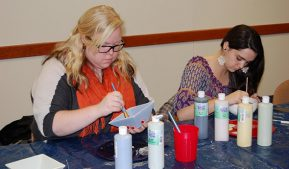 Photo of students painting bowls