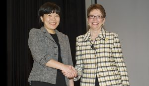 Photo of Dr. Ye He and Chancellor Brady