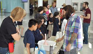 Photo of UNCG master's student Jesse Plotkin (right) does a demonstration about enzymes. Photo courtesy JSNN
