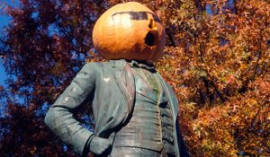 Photo of McIver Statue with pumpkin