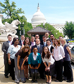 Photo of UNCG students posing if front of Capitol Building in Washington D.C.