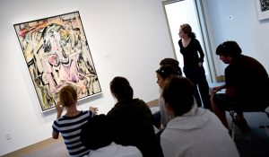 """Photo of students viewing Kooning's """"Woman"""" painting"""