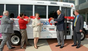 Photo of ribbon cutting for the Nano bus