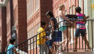 Photo of students moving into residence hall