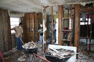 Photo of UNCG students working during service trip to New Orleans, March 2006