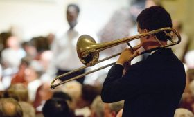 Photo of student playing trombone during past Collage Concert
