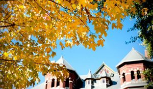 Photo of Foust Building with fall foliage