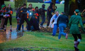 """Action photo of students playing """"Humans vs. Zombies"""""""