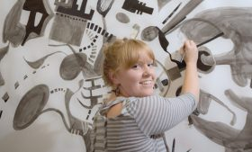 Emily Clark-Kramer pictured with her artwork