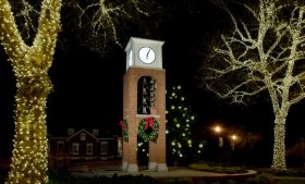 Photo of Bell Tower at dark with decorative lights