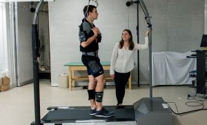Photo of Kristen Schleich working with student on treadmill