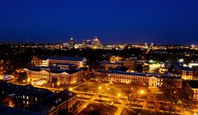 Photo of Greensboro skylight with UNCG campus at night.