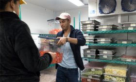 Photo of Levi Saavedra working with the Food Recovery Network