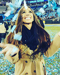 Photo of Dominique Madruga watching confetti fall after a Panthers win