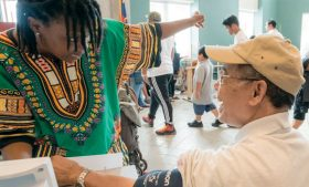 Photo of Jalisa Horne working with a Montagnard patient