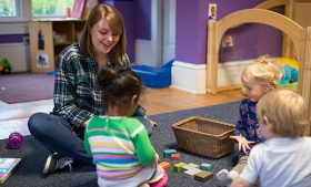 Photo of Emma Rettew working with children