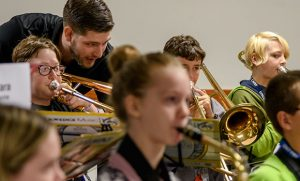 Camp counselor Lars Holmberg works with young musicians at UNCG Summer Music Camp.