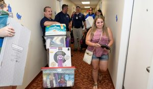 Students moving into residents halls during move-in.