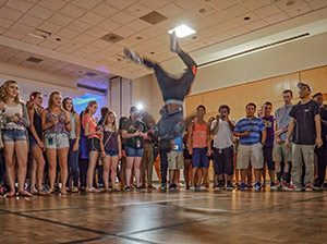 UNCG students form a dance circle at the 2015 Party Like a Rawkstar event.