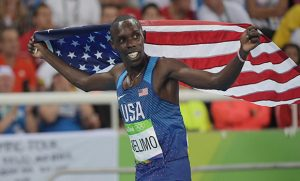 Photo of Paul Chelimo holding US flag after winning silver medal