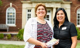 Picture of Kattya Castellón and Margarita Kerkado in front of the Undergraduate Admissions building