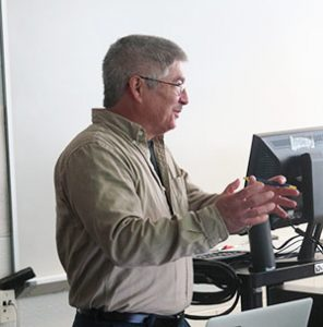 Dr. Chuck Bolton teaching in a classroom