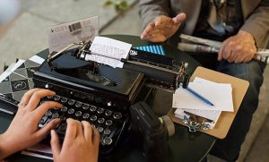 Picture of person typing letter on typewriter