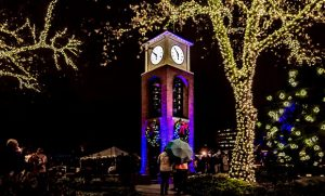 Photo of bell tower and anniversary plaza with holiday lights