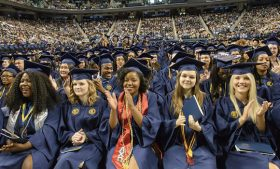 Photo of students clapping at commencement ceremony