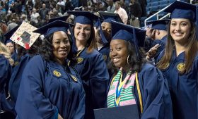 Graduates pose for a picture during December Commencement.
