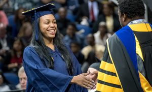 Photo of graduate shaking Chancellor Gilliam's hand