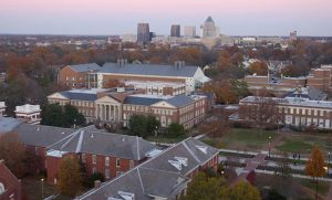 Aerial photo of campus with downtown Greensboro in background