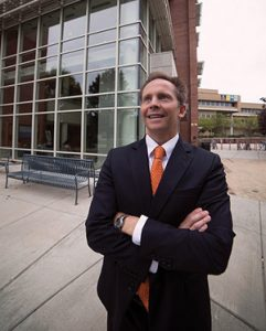 Portrait of Dr. Randall Penfield standing outside the School of Education building on campus