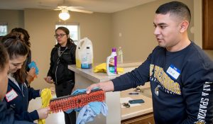 UNCG student Osbin Perdomo hands out cleaning supplies to fellow Spartans