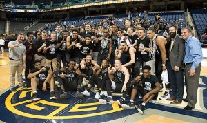 group photo of UNCG Men's Basketball team after earning SOCON title
