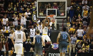 Senior Diante Baldwin dunks the ball, crowd cheers behind the basket