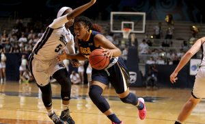 Action photo of Te'ja Twitty driving to the hoop