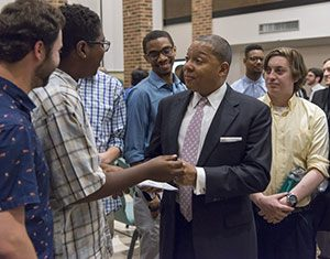 Wynton Marsalis talking with a group of students