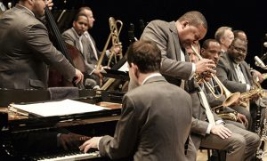 Wynton Marsalis playing trumpet with orchestra