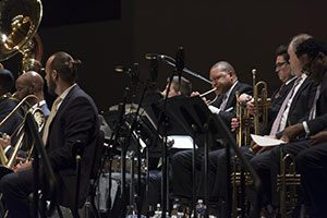 Wynton Marsalis playing the trumpet on stage