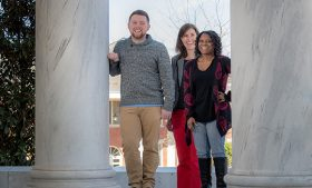 Dane Hansen, Kara Baldwin and Marlina Avery (left to right), stand on the steps of Jackson Library.