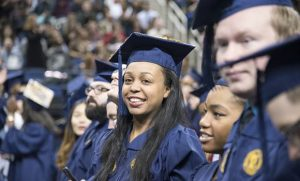 Photo of student smiling at commencement cermeony