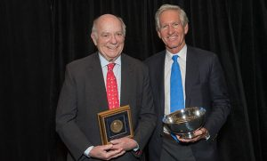Photo of Joseph M. Bryan Jr. and Bobby Long Jr. holding awards after ceremony