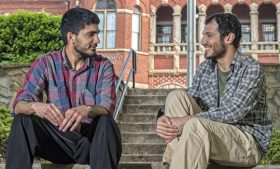 Photo of Ahmet Tanhan talking with freshman Zargham Muhammad on steps in Foust Park